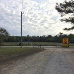 Entrance to the Enfield/Rocky Mount KOA with cotton fields across the street