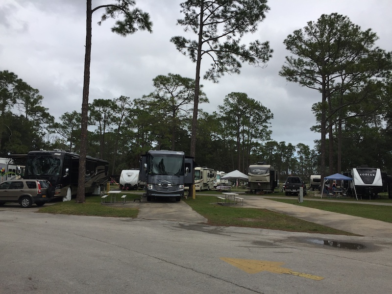 Overview of Elite sites with concrete parking pads at Sunshine Holiday Daytona Encore RV Resort