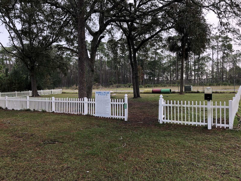 Large enclosed dog park at Sunshine Holiday Daytona Encore RV Resort