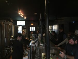 The dark, comfy interior of Black Mountain Brewing